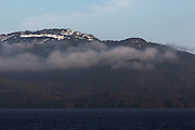 Fog rises along tree-covered mountains as we head towards Prince Rupert on Canada's Inside Passage