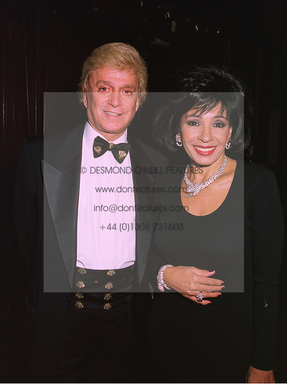 Singer SHIRLEY BASSEY and MR BAUDOIN MILLS, at a wedding in London on 6th December 1997.MED 22