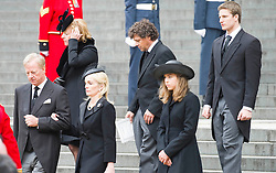 Mark Thatcher (front L), son of Margaret Thatcher, stands with his wife Sarah (front R), his children Amanda and Michael and his twin sister Carol Thatcher (back L) and her partner Marco Grass (back R) follow the coffin as they leave St Paul's Cathedral at the end of the ceremonial funeral, St Paul's Cathedral, London, UK, Wednesday 17 April, 2013, Photo by: i-Images