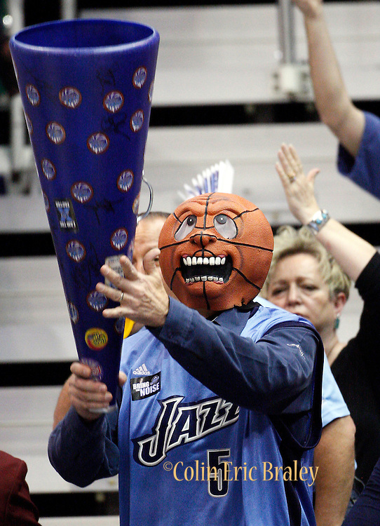 A Utah Jazz fan watches Game 4 of the NBA Western Conference first-round playoff series against the Denver Nuggets in Salt Lake City, Sunday, April 25, 2010. (AP Photo/Colin E Braley)