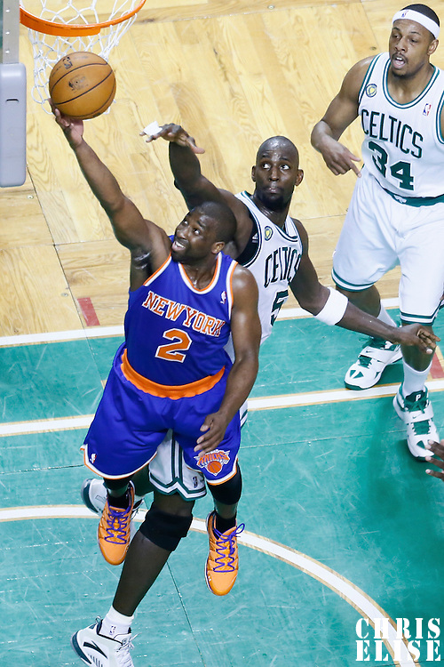 26 April 2013: New York Knicks point guard Raymond Felton (2) goes for the layup past Boston Celtics center Kevin Garnett (5) during Game Three of the Eastern Conference Quarterfinals of the 2013 NBA Playoffs at the TD Garden, Boston, Massachusetts, USA.