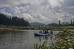 August 6, 2017 - Gulmarg, Jammu and Kashmir, India - General view of meadows around Gulmarg Golf Course and resort on August 06, 2017 in Gulmarg, in the Baramula district of Kashmir, India. Located 54 km (35 miles) to the west of Srinagar, the summer capital of Indian-administered Kashmir, the world famous tourist and trekking resort of Gulmarg at an altitude of 2,650 meters, claims to have the highest green golf course in the world and as a winter resort for long-run skiing, snow-boarding, heli-skiing. The valley of Gulmarg, a large meadow about 3- Square kilometer in area. The name means Meadow Of Flowers and in the spring its just that, a rolling meadow dotted with countless colorful Bluebells, Daisies, Forget Me Not and Buttercups. The valley itself is about 3-km long and up to a km wide. A popular destination for British travellers prior to the 1998 outbreak of armed rebellion against Indian rule in Kashmir, located less than six miles from the ceasefire line or Line of Control (LoC) a military line that divides Kashmir between India and Pakistan. Tourists have begun to return to Kashmir as various foreign governments have relaxed their travel advisory warnings to citizens travelling in the previously strife-torn region. (Photo by Yawar Nazir/NurPhoto) (Credit Image: © Yawar Nazir/NurPhoto via ZUMA Press)