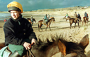Eighteen year old Dessie Cummins from Dublin who is training to be a jockey, with some of the other students on the beach at Culleenamore, Strandhill, Sligo. Photo: James Connolly/GreenGraph
