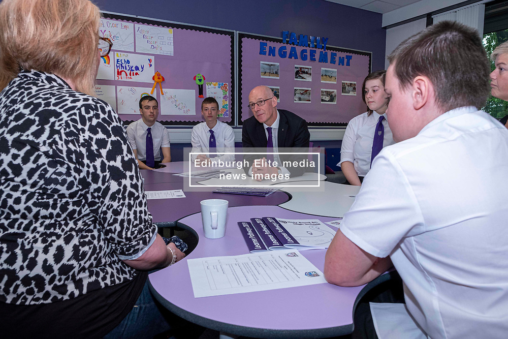 Pictured: John Swinney got to hear how the programme is working for parents and students in the Family Engagement room<br /><br />The Deputy First Minister visited Holy Rood High School in Edinburgh today to meet parents and pupils before announcing GBP50 million funding for improving attainment.  The results of a survey of headteachers were also published during the Deputy First Minister's visit.<br /><br /> Ger Harley | EEm 30 May 2019