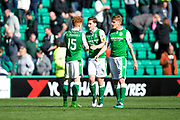 Hibernian defender Paul Hanlon (#4) and Hibernian midfielder Vykintas Slivka (#8) congratulate man of the match Hibernian forward Simon Murray (#15) following the Ladbrokes Scottish Premiership match between Hibernian and Partick Thistle at Easter Road, Edinburgh, Scotland on 5 August 2017. Photo by Craig Doyle.