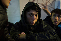 A young Afghan migrant from Mazar-i-Sharif sits in the port of Mytilene, on the Greek island of Lesbos, waiting for a 1:00 a.m. ferry to Athens, from where he will continue north toward Germany.