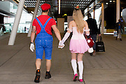 UNITED KINGDOM, London: 23 October 2015 Cosplay fans leave the 2015 MCM London Comic Con which is being held at London's ExCel Arena. The event will be host to more than 110,000 comic con fans and cosplay enthusiasts over the weekend. Rick Findler / Story Picture Agency