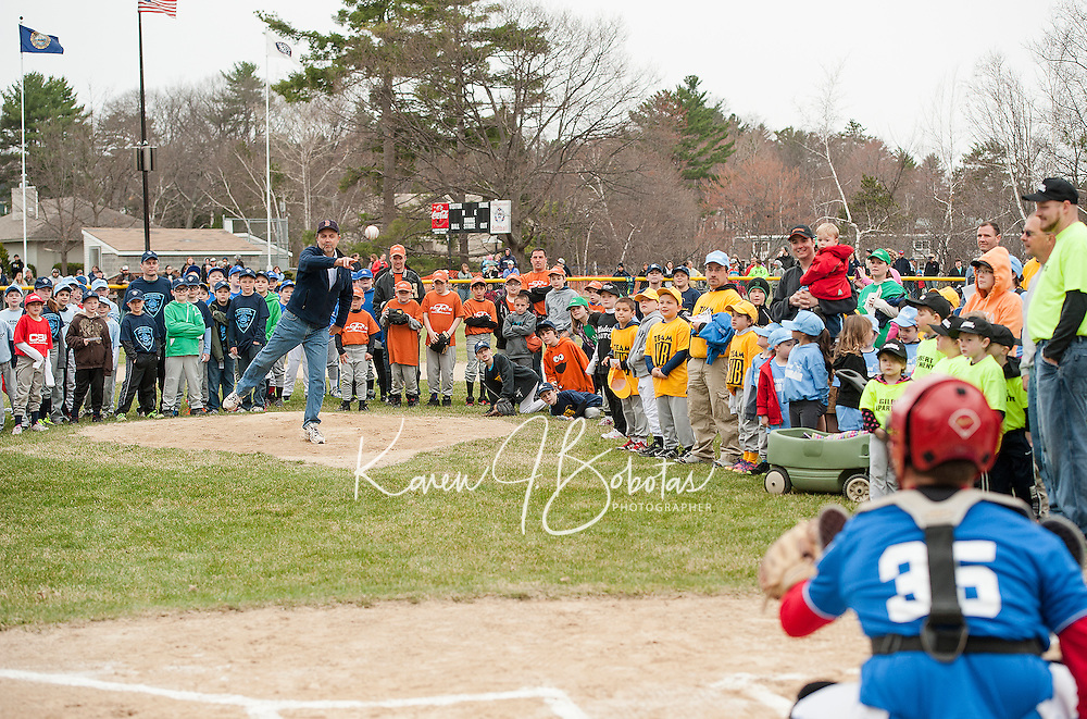 Mayor Ed Engler throws the first pitch to Rotary Majors catcher Tyler Richter during Opening Day festivities for Laconia Little League on Saturday morning at Colby Field.  (Karen Bobotas/for the Laconia Daily Sun)