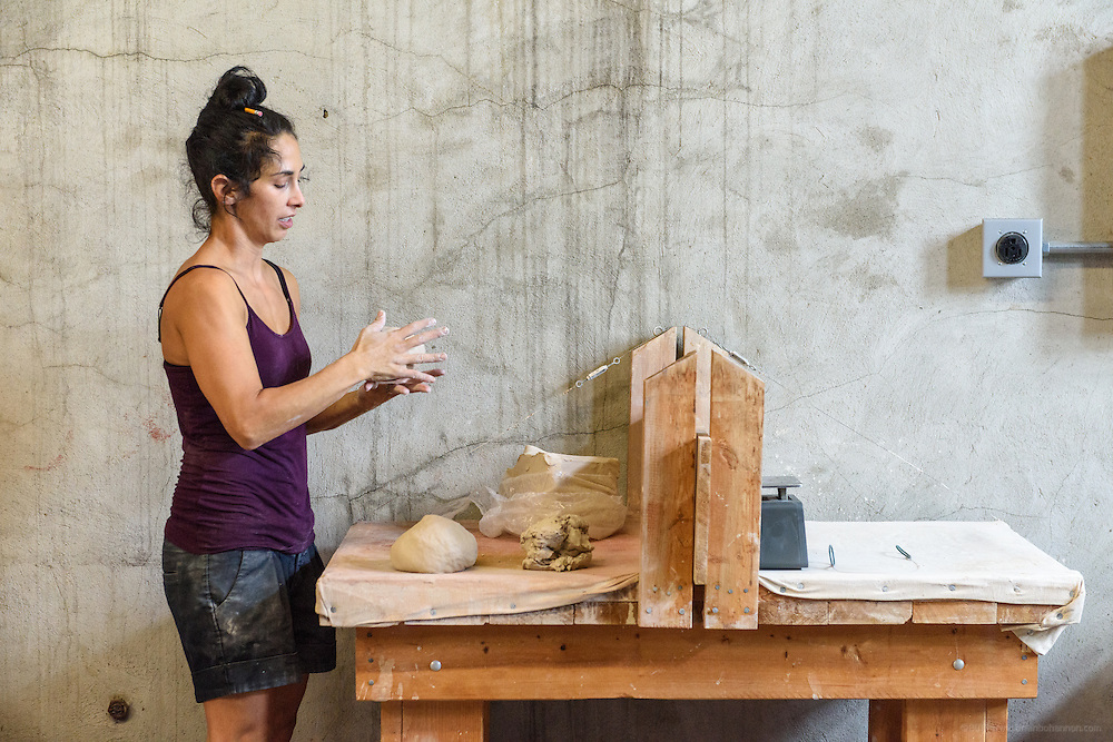Lisa Simon, a laid-off teacher at Jefferson Community and Technical College, now has a residency at Kentucky Mudworks at 506 Baxter Avenue where she works about 12 hours a week and makes art in the studio space provided there. (Photo by Brian Bohannon)