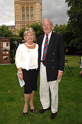 TV presenter JUDITH CHALMERS and her husband MR NEIL DURDEN-SMITH at the Lady Taverners Westminster Abbey Garden Party, The College Garden, Westminster Abbey, London SW1 on 10th July 2007.<br /><br />NON EXCLUSIVE - WORLD RIGHTS