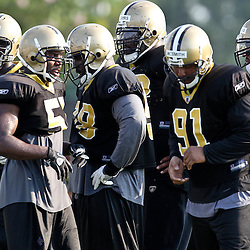 August 6, 2011; Metairie, LA, USA; New Orleans Saints defenders Alex Brown (96), Jonathan Vilma (51), Sedrick Ellis (98) Shaun Rogers (92), Will Smith (91), Jonathan Casillas (52) during training camp practice at the New Orleans Saints practice facility. Mandatory Credit: Derick E. Hingle