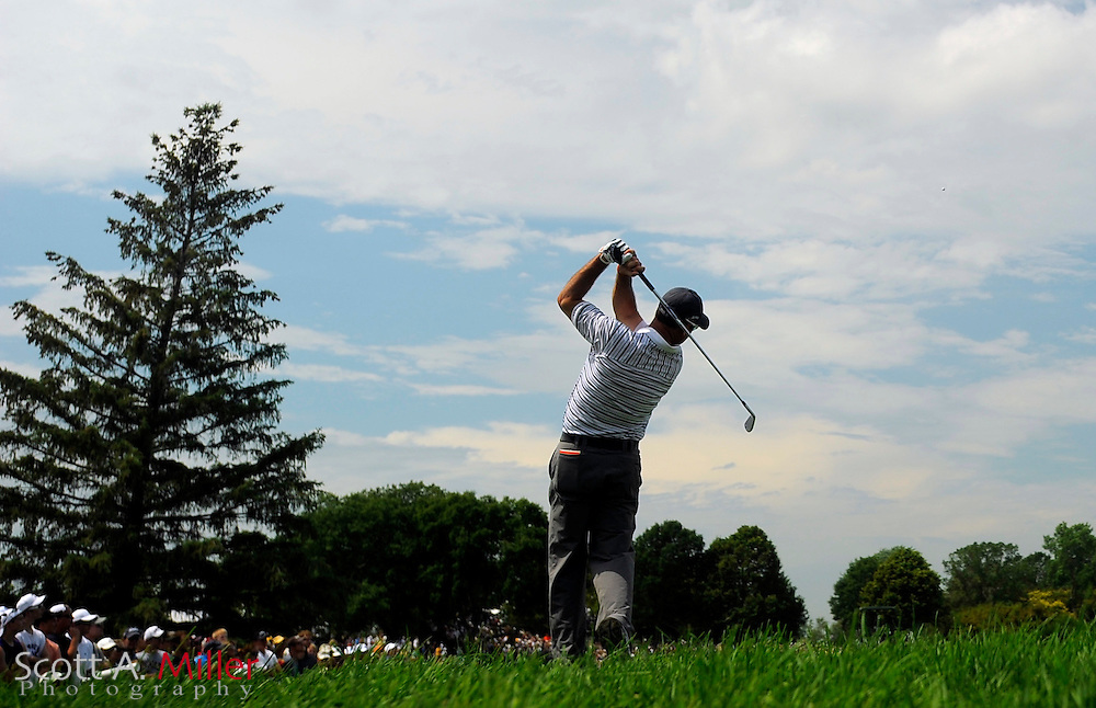 Aug 13, 2009; Chaska, MN, USA; Rich Beem (USA) hits a shot on the 8th hole during the first round of the 2009 PGA Championship at Hazeltine National Golf Club.  ©2009 Scott A. Miller