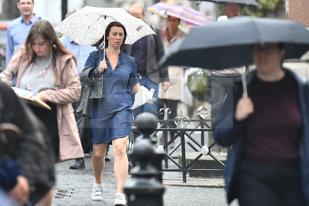 © Licensed to London News Pictures. 25/09/2019. London, UK. Commuters are seen battling through heavy rain on theor way to work in the capital. The UK has been deluged with rain causing flash floods in parts. Photo credit: Ben Cawthra/LNP