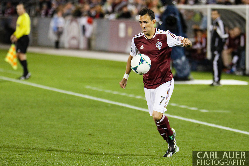 September 14th, 2013 -  Colorado Rapids forward Vicente Sánchez (7) gathers in a pass in the first half of action in the MLS Soccer game between FC Dallas and the Colorado Rapids at Dick's Sporting Goods Park in Commerce City, CO