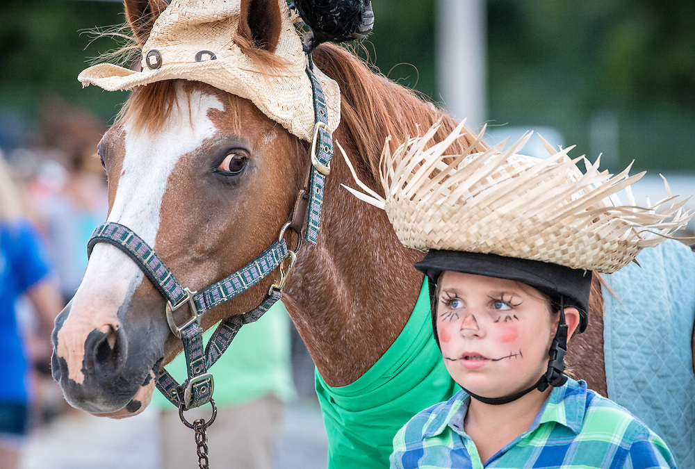 Timonium, Maryland - Young boy and his horse walk together in costume at the 2016 Maryland State Fair.