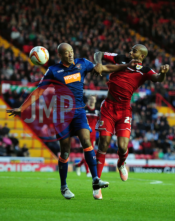 Bristol City's Marvin Elliott battles for the ball with Blackpool's Alex John-Baptiste - Photo mandatory by-line: Joe Meredith/JMP  - Tel: Mobile:07966 386802 17/11/2012 - Bristol City v Blackpool - SPORT - FOOTBALL - Championship -  Bristol  - Ashton Gate Stadium -