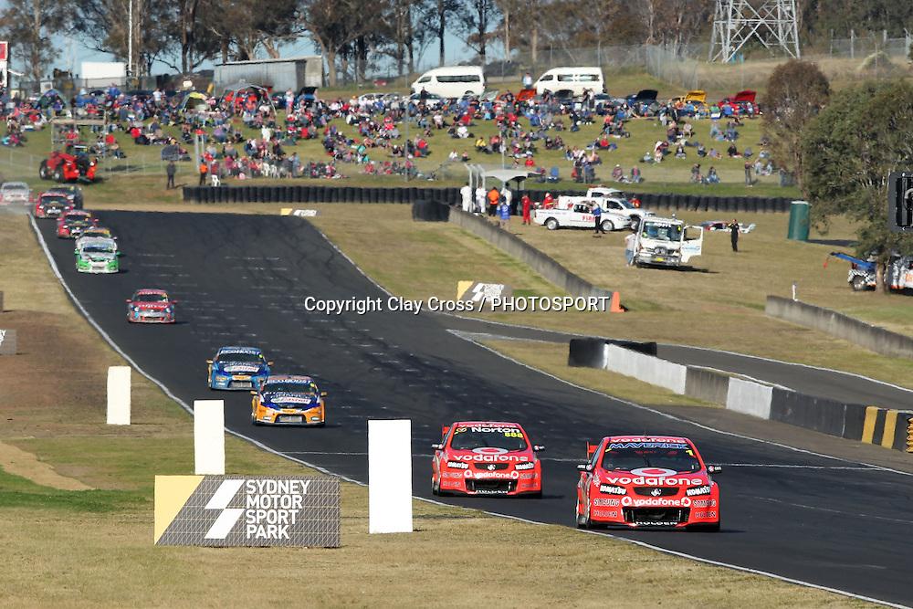 Jamie Whincup (TeamVodafone Holden) leads Lowndes, Davison, Winterbottom.  Sydney Motorsport Park 360 ~ Race 19 2012 V8 Supercar Championship Series. Sydney Motorsport Park, Sydney on Sunday 26 August 2012. Photo: Clay Cross / photosport.co.nz