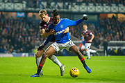 Joe Aribo (#17) of Rangers FC shields the ball from Christophe Berra (#6) of Heart of Midlothian FC during the Ladbrokes Scottish Premiership match between Rangers FC and Heart of Midlothian FC at Ibrox Park, Glasgow, Scotland on 1 December 2019.
