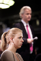 Nederland. Den Haag, 26 februari 2010.<br /> Danielle de Winter, nummer vijf van de kandidatenlijst in Den Haag. Achtergrond : Geert Wilders die de zaal in gaat om vragen van aanwezigen op te halen.<br /> Partij voor de Vrijheid, PVV. Campagnebijeenkomst in een zaaltje Ockenburgh Active in het kader van de gemeenteraadsverkiezingen. Politieke partij, aanhang, Geert WildersPolitiek, lokale politiek<br /> Foto Martijn Beekman