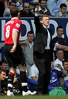 Photo: Paul Thomas.<br /> Everton v Manchester United. The Barclays Premiership. 28/04/2007.<br /> <br /> David Moyes, Everton manager, yells instructions to his team infront of old Everton player Wayne Rooney.