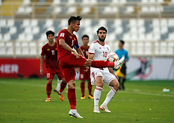 January 12, 2019 - Abu Dhabi, Abu Dhabi, United Arab Emirates - Quế Ngọc Hải of Vietnam clearing the ball in front of Karim Ansarifard of Iran  during Vietnam v Iran, AFC Asian Cup football, Nahyan Stadium, Abu Dhabi, United Arab Emirates on January 12, 2019  (Credit Image: © Ulrik Pedersen/NurPhoto via ZUMA Press)