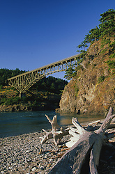 North America, United States, Washington, Whidbey Island, bridge and driftwood on beach at Deception Pass State Park