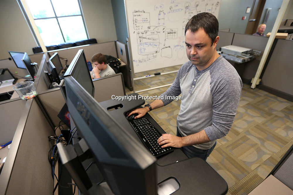 Jay Weaver, Senior Software Engineer at Circadence in Tupelo, works on some code at his work station.