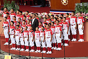 Former Los Angeles Dodger Chen Chin-feng sings the national anthem with an elementary school baseball team as part of the Republic of China (Taiwan) National Day celebration on October 10, in front of the Presidential Palace in Taipei.<br />