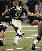 NEW ORLEANS - OCTOBER 10:  Kicker John Carney #3 of the New Orleans Saints kicks a field goal in the fourth quarter to bring his team within three points against the Tampa Bay Buccaneers at the Louisiana Superdome on October 10, 2004 in New Orleans, Louisiana. The Bucs defeated the Saints 20-17. ©Paul Anthony Spinelli *** Local Caption *** John Carney