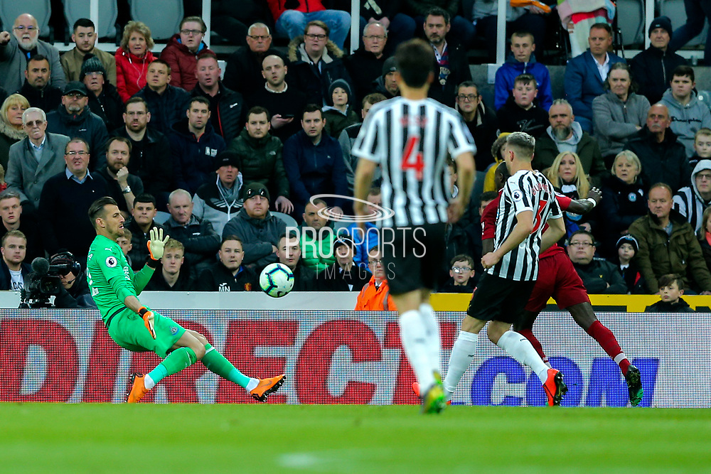 Martin Dubravka (#12) of Newcastle United saves the shot from Daniel Sturridge (#15) of Liverpool during the Premier League match between Newcastle United and Liverpool at St. James's Park, Newcastle, England on 4 May 2019.