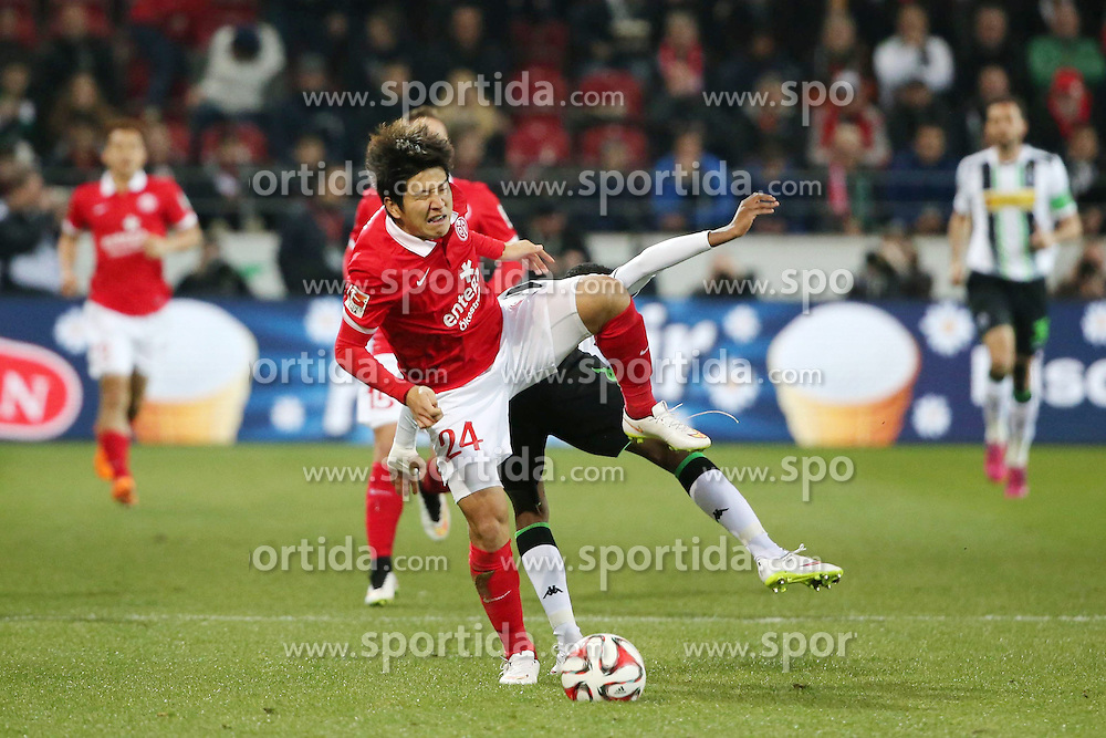 07.03.2015, Coface Arena, Mainz, GER, 1. FBL, 1. FSV Mainz 05 vs Borussia Moenchengladbach, 24. Runde, im Bild v.l.: Jo-Hoo Park (Mainz) gegen Ibrahima Traore (Gladbach) // during the German Bundesliga 24th round match between 1. FSV Mainz 05 and Borussia Moenchengladbach at the Coface Arena in Mainz, Germany on 2015/03/07. EXPA Pictures &copy; 2015, PhotoCredit: EXPA/ Eibner-Pressefoto/ Neurohr<br /> <br /> *****ATTENTION - OUT of GER*****