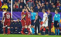 SEVILLE, SPAIN - Tuesday, November 21, 2017: Liverpool's Emre Can is shown a yellow card by referee Felix Byrch during the UEFA Champions League Group E match between Sevilla FC and Liverpool FC at the Estadio Ramón Sánchez Pizjuán. (Pic by David Rawcliffe/Propaganda)