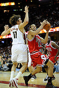 Apr 19, 2010; Cleveland, OH, USA; Chicago Bulls center Joakim Noah (13) shoots over Cleveland Cavaliers forward Anderson Varejao (17) during the fourth period in game two in the first round of the 2010 NBA playoffs at Quicken Loans Arena. The Cavaliers beat the Bulls 112-102. Mandatory Credit: Jason Miller-US PRESSWIRE