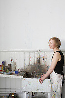 Artist standing by sink in studio