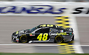 NASCAR Cup Series driver Jimmie Johnson (48) crosses the start, finish line during a practice run at Kansas Speedway in Kansas City, Kan., Friday, May 11, 2018. (AP Photo/Colin E. Braley)