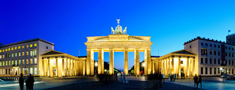 Panorama of evening view of the Brandenburg Gate, one of Europe's and the world's most recognizable and historic landmarks in the heart of the historic city of Berlin, the capital of Germany.
