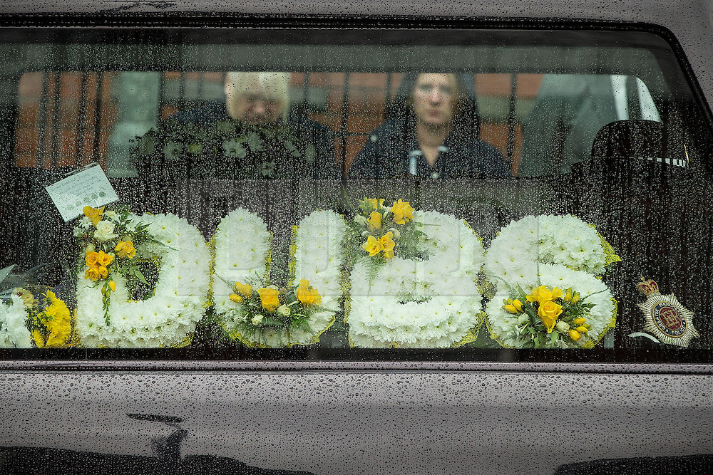 © Licensed to London News Pictures . 15/07/2016 . Bolton , UK . Flowers in the hearse .  The funeral of Special Constable Samantha Derbyshire at St Mary's RC Church in Horwich , Bolton. Derbyshire was struck and killed by an HGV on the M61 motorway following a collision , in the early hours of Monday 11th July 2016 . Photo credit : Joel Goodman/LNP