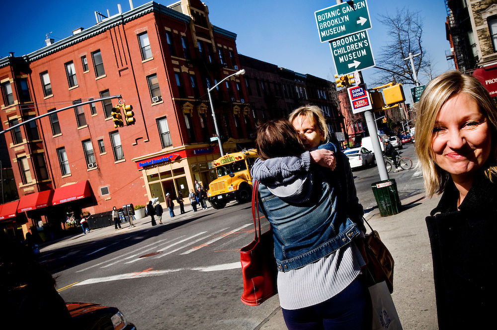 Writers in Park Slope, Brooklyn.Siri Hustvedt hugging a friend on the street, Naja Marie Aidt (right)