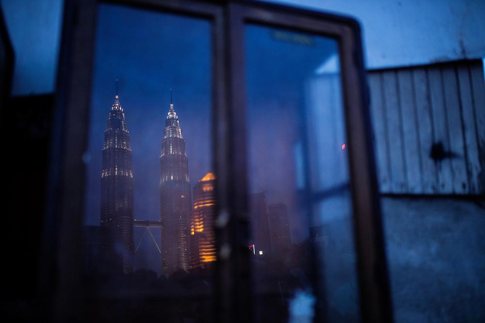 Petronas Twin Towers seen from Kampung Baru, Kuala Lumpur, Malaysia.