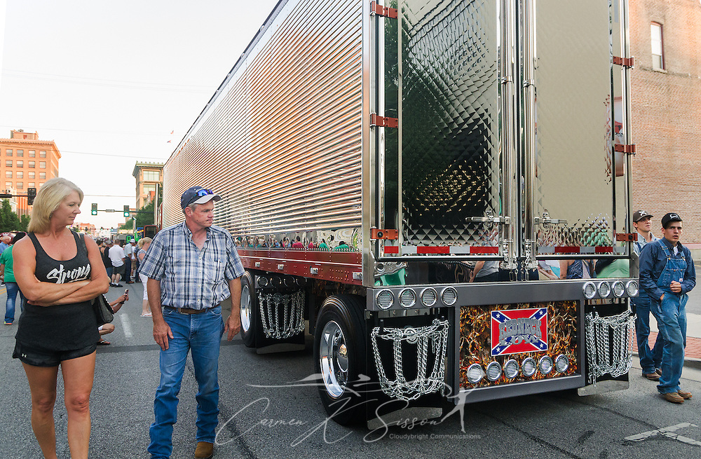 "Truck enthusiasts inspect ""Redneck Low,"" Sweet Rides Logistics' 2005 Kenworth T600 and 2017 Wabash Trailer, after the Shell Rotella SuperRigs parade, June 10, 2016, in Joplin, Missouri. SuperRigs, organized by Shell Oil Company, is an annual beauty contest for working trucks. Approximately 89 trucks entered this year's competition. (Photo by Carmen K. Sisson/Cloudybright)"
