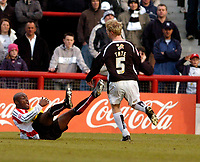 Photo: Leigh Quinnell.<br /> Brentford v Swansea City. Coca Cola League 1.<br /> 26/12/2005.Swanseas Alan Tate fouls Brentfords lloyd Owusu, which got Tate sent off after a second yellow card.