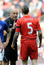 Referee Howard Webb discusses a matter with Daniel Agger of Liverpool during the Budweiser FA Cup semi final match between Liverpool and Everton at Wembley on Saturday 14 April 2012 (Photo by Rob Munro)