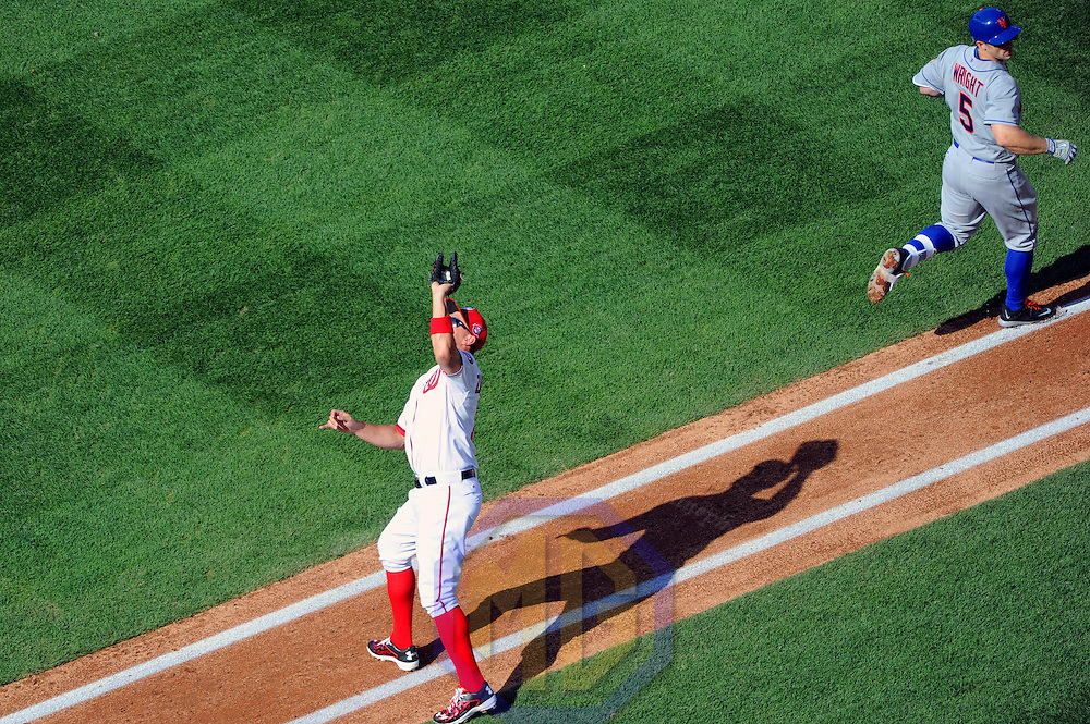 06 April 2015:  Washington Nationals first baseman Ryan Zimmerman (11) retires New York Mets third baseman David Wright (5) on opening day at Nationals Park in Washington, D.C. where the New York Mets defeated the Washington Nationals, 3-1.