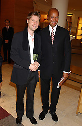 """Left to right, CHRISTOPHER BAILEY and MICHAEL ROBERTS  at a party hosted by Christopher Bailey to celebrate the launch of """"The Snippy World of New Yorker Fashion Artist Michael Roberts"""" held at Burberry, 21-23 New Bond Street, London on 20th September 2005.<br /><br />NON EXCLUSIVE - WORLD RIGHTS"""