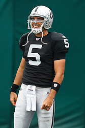 November 7, 2010; Oakland, CA, USA;  Oakland Raiders quarterback Bruce Gradkowski (5) warms up before the game against the Kansas City Chiefs at Oakland-Alameda County Coliseum. Oakland defeated Kansas City 23-20 in overtime.