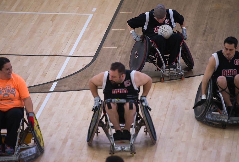 Athletes participate in the the 8th Annual FourPlay! Quad Rugby Tournament in the Ping Recreation Center on Oct. 4, 2014. Photo by Lauren Pond