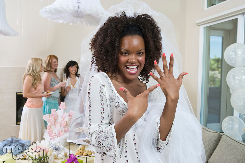 Bride showing her engagement ring at bridal shower