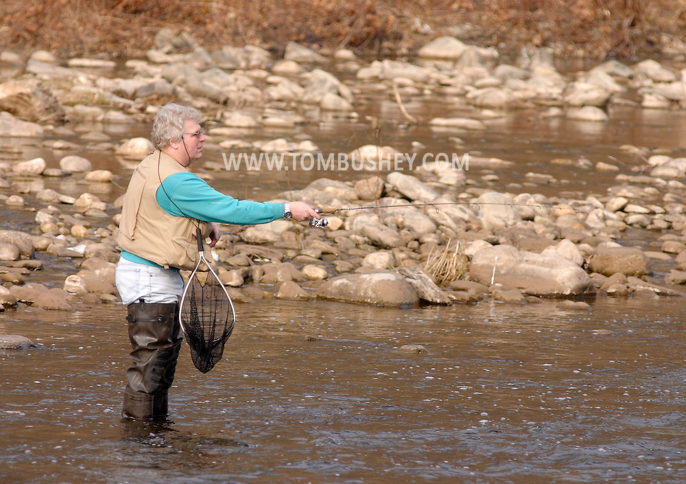 Cuddebackville, N.Y. - A man in waders fishes in the Neversink River on the opening day of trout season. April 1, 2006. © Tom Bushey/The Image Works
