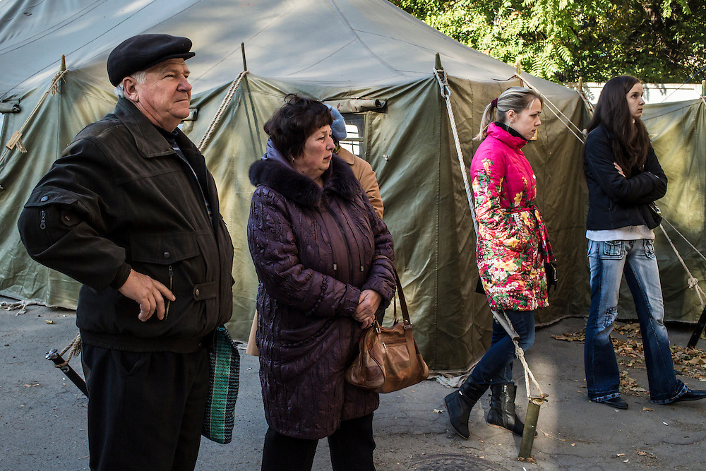 DNIPROPETROVSK, UKRAINE - OCTOBER 11: People wait for the opening of a center to help people displaced by fighting in Ukraine's East on October 11, 2014 in Dnipropetrovsk, Ukraine. The United Nations has registered more than 360,000 people who have been forced to leave their homes due to fighting in the East, though the true number is believed to be much higher. (Photo by Brendan Hoffman/Getty Images) *** Local Caption ***