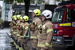 © Licensed to London News Pictures. 28/04/2020. London, UK. A one minute silence is observed at North Kensington Fire Station in Notting Hill, West London in honour of care workers who lost their lives in the fight against COVID-19. British Prime Minister Boris Johnson, who retuned to Downing Street on Monday, has warned the public against relaxing lockdown precautions too soon. Photo credit: Ben Cawthra/LNP